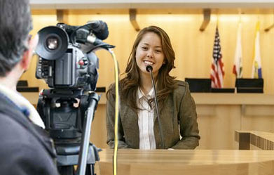 female giving a deposition video
